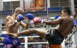 Tiger Muay Thai trainer Dernkabuan fights at Bangla boxing stadium in Phuket, Thailand, Wednesday, Aug. 14, 2013. (Photo by Mitch Viquez ©2013)