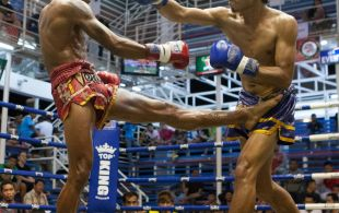 Tiger Muay Thai fighter Petdam fights at Bangla stadium in Phuket, Thailand, Friday, Jun. 21, 2013. (Photo by Mitch Viquez ©2013)
